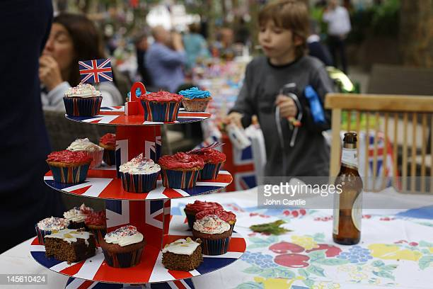 Cupcakes adorn a Union Jack platter during a street party on Niton Street on June 2 2012 in Fulham southwest London England For only the second time...