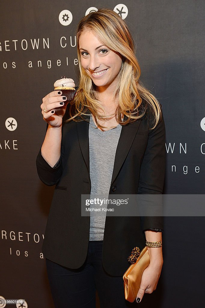'Cupcakes and Cashmere' blogger Emily Schuman attends the Los Angeles Grand Opening of Georgetown Cupcake Los Angeles on November 15, 2012 in Los Angeles, California.