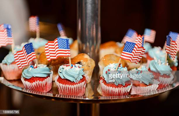 Cupcakes bearing a US flag are pictured during a special event for USA's presidential elections in Brussels city hall on November 7 2012 US President...