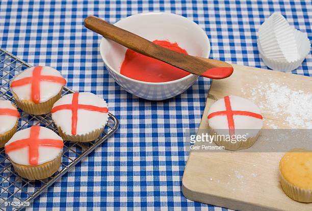 Cupcakes decorated with flags on baking tray