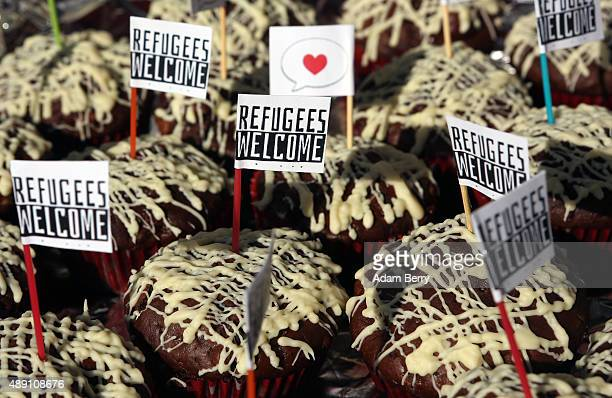 Cupcakes featuring flags with the words 'Refugees Welcome' are seen at a welcome festival for migrants on September 19 2015 in the Karolinenviertel...