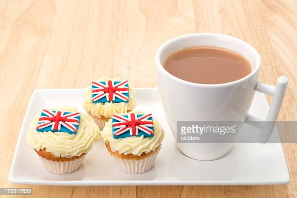 Cupcakes with a UK flag decoration and tea