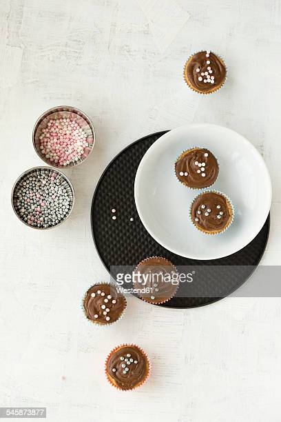 Cupcakes with chocolate and sugar pearls