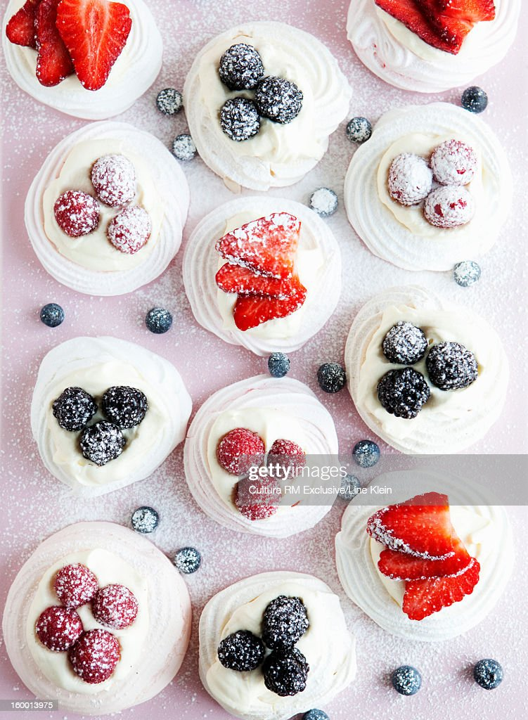 Cupcakes with fruit and frosting : Stock Photo