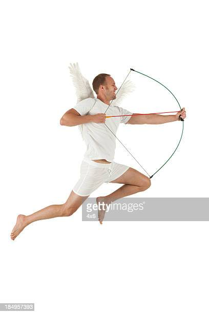 Cupid aiming with a bow and arrow