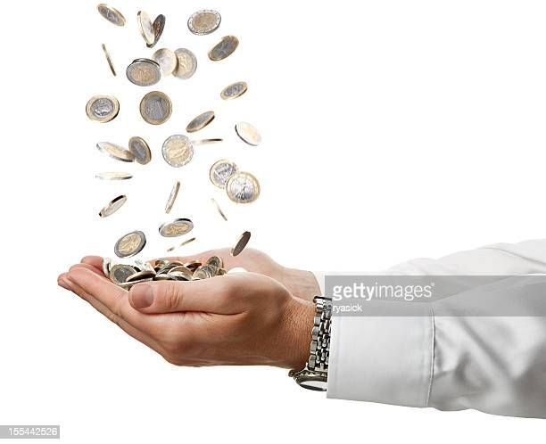 Cupped Businessman Hands Catching Falling Euro Coins Isolated On White