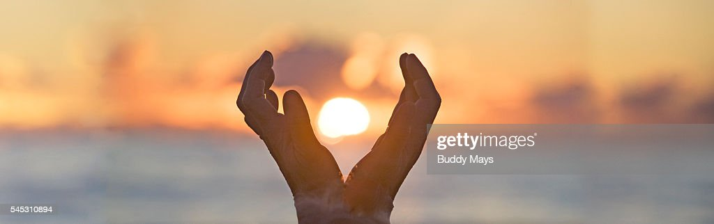 Cupped Hands Holding The Sun