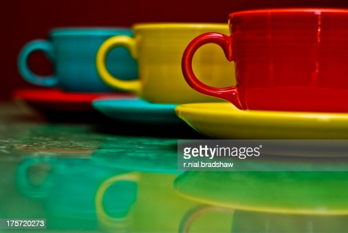 cups and saucers on table with reflection