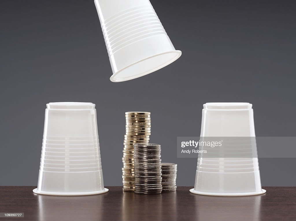 Cups and stacks of coins : Stock Photo