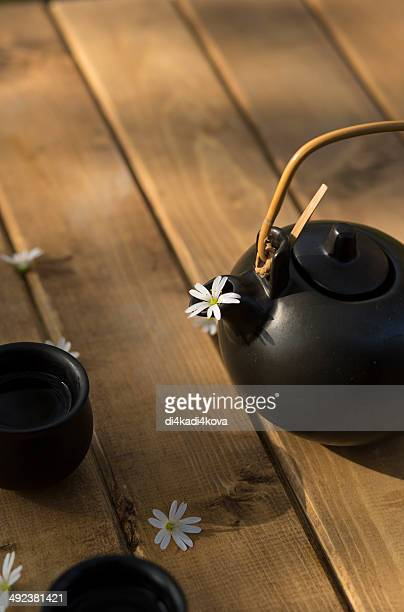 Cups and teapot on a wooden table.