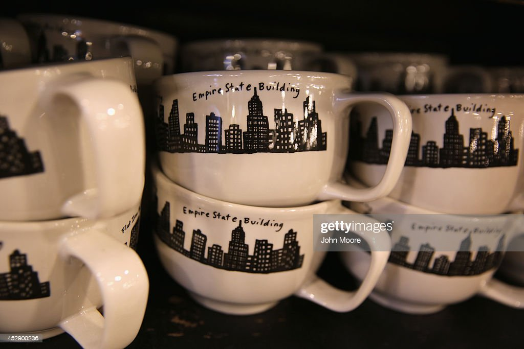 Cups from the '212 New York Skyline' collection sit on a display shelf at Fishs Eddy, a well-known housewares store on Broadway and 19th St. in Manhattan on July 29, 2014 in New York City. The Port Authority of New York and New Jersey has accused the shop of 'unfairly reaping a benefit from an association with the Port Authority and the attack' of September 11. The Authority has asked the store to stop selling anything with these 'assets' on them, such as the Twin Towers, One World Trade Center and the Lincoln and Holland tunnels.