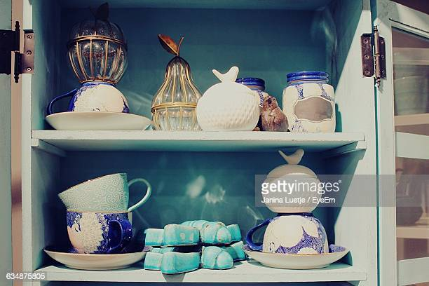 Cups In Cupboard At Kitchen
