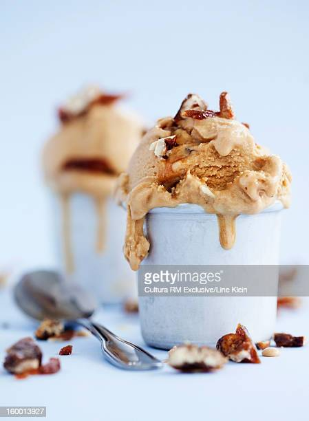 Cups of caramel ice cream with nuts