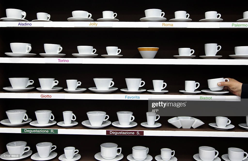 Cups of coffee are displayed during the exhibition 'World of coffee', on June 27, 2013, in Nice, southeastern France. AFP PHOTO / JEAN CHRISTOPHE MAGNENET