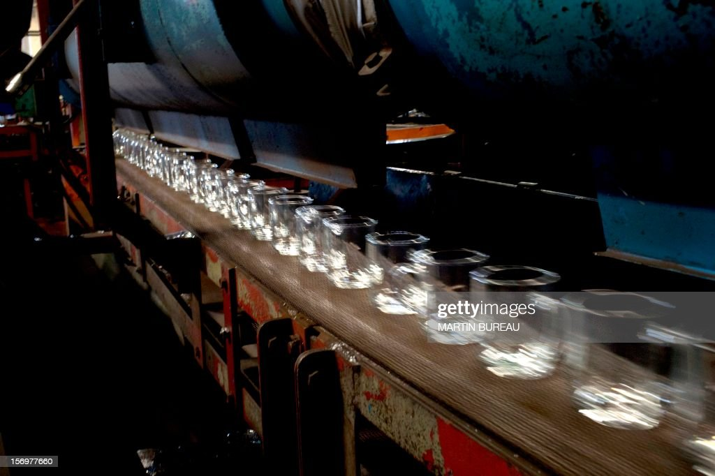 Cups of French manufacturer of glassware Duralex are seen on a production line, on November 26, 2012 at the factory in La Chapelle-Saint-Mesmin.