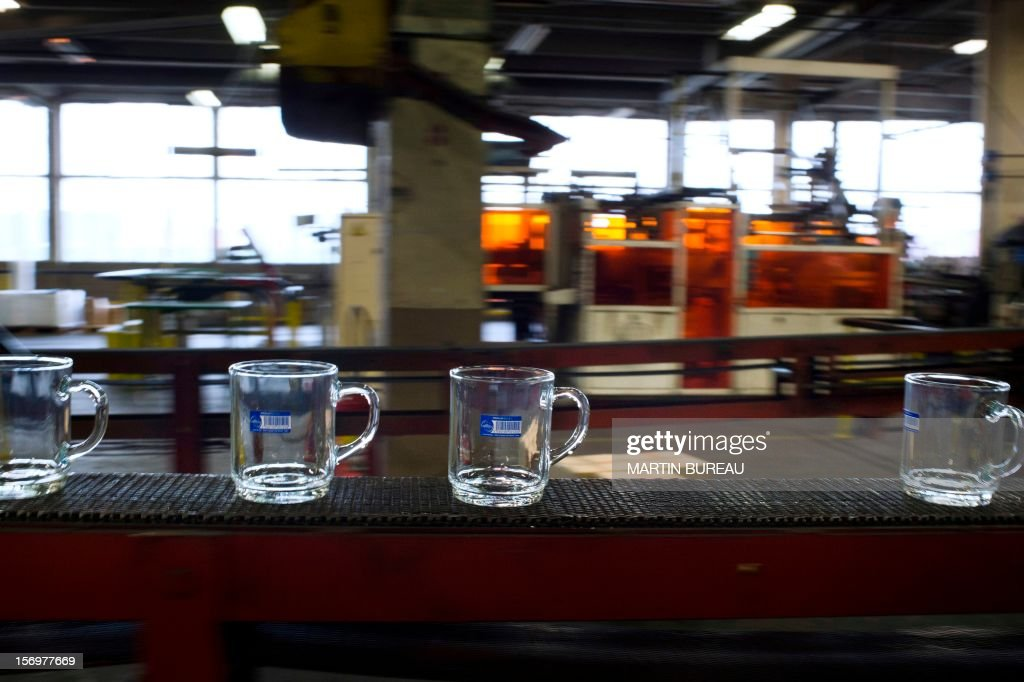 Cups of French manufacturer of glassware Duralex are seen on a production line, on November 26, 2012 at the factory in La Chapelle-Saint-Mesmin. AFP PHOTO MARTIN BUREAU