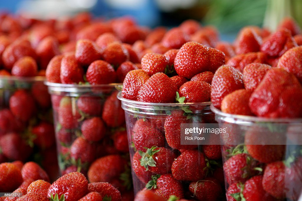 Cups of fresh strawberries