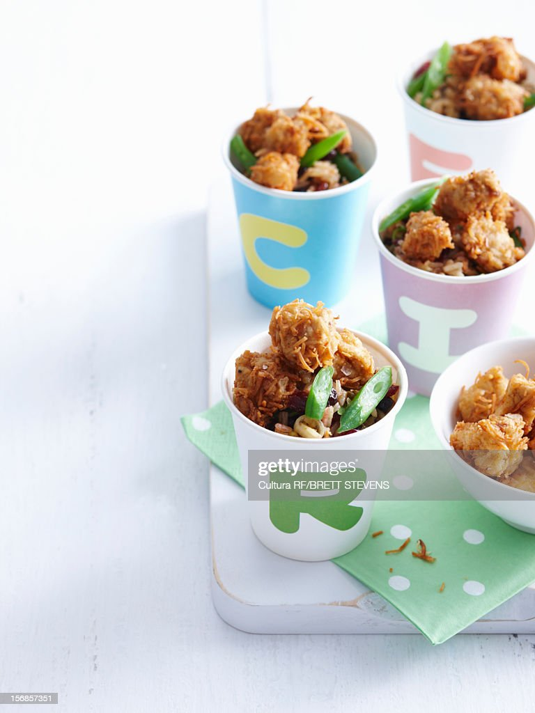 Cups of fried chicken bites : Stock Photo