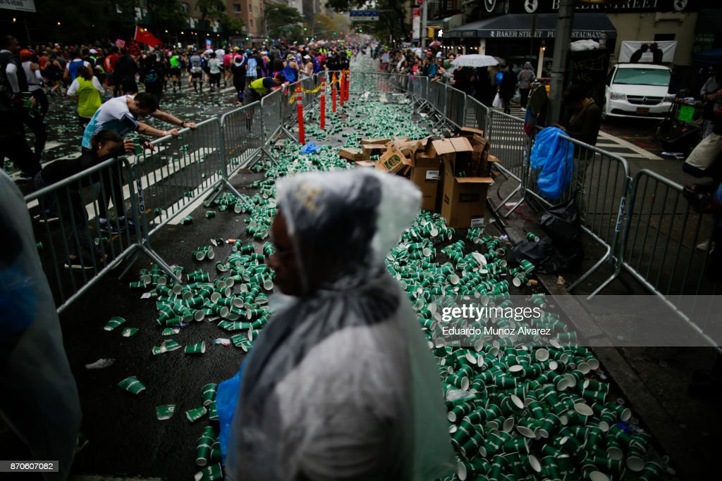 Cups used for hydration are seen on the ground of 1st Ave, as runners make their way in Manhattan during 2017 TCS New York City Marathon, November 5, 2017 in New York. NYPD department had doubled the number of rooftop observation posts and countersniper teams in all five boroughs. More uniformed police officers, counterterrorism officers and police dogs will patrol the event. more than 50,000 runners from more than 125 countries and all 50 states are expected to pass before some 2.5 million spectators. Established in 1970, the annual race winds through all of New York City's five boroughs.