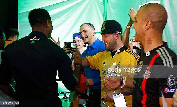 Curaao national football team coach Patrick Kluivert greets fans at the 2015 UEFA Champions League Trophy Tour presented by Heineken exhibition on...