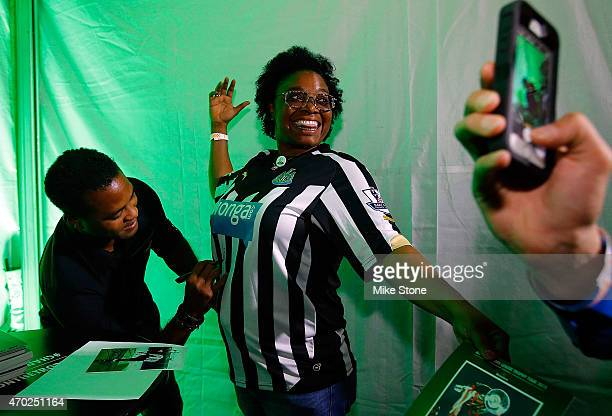 Curaao national football team coach Patrick Kluivert signs a fan's jersey at the 2015 UEFA Champions League Trophy Tour presented by Heineken...