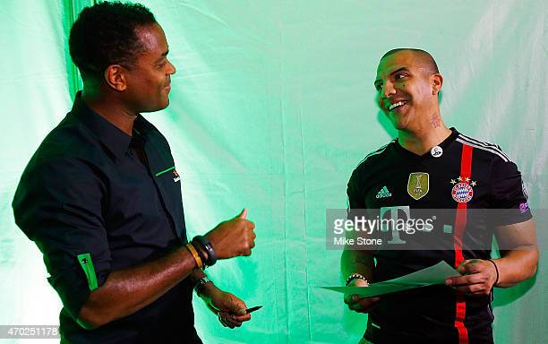 Curaao national football team coach Patrick Kluivert talks with a fan at the 2015 UEFA Champions League Trophy Tour presented by Heineken exhibition...