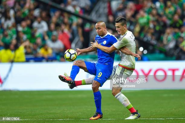 Curacao forward Gino Van Kessel and Mexico defender César Montes try to gain control of the ball during the CONCACAF Gold Cup soccer match between...