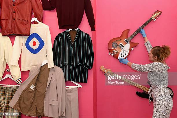 A curator adjusts guitars on display in 'The Jam About the Young Idea' at Somerset House on June 25th 2015 in London England With unprecedented...