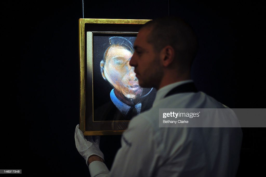 A curator adjusts 'Self Portrait' by Francis Bacon at Sotheby's on June 14, 2012 in London, England. This piece is part of the Impressionist & Modern and Contemporary Art sale at Sotheby's which will be held on June 19, 2012 and June 20, 2012.