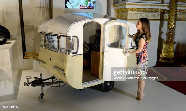 Curator Anna Reynolds adds the finishing touches to a Miniature Caravan made by Rollalong presented to Prince Charles and Princess Anne by the...