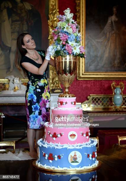 Curator Anna Reynolds adds the finishing touches to a replica of the Christening Cake of Prince Leopold Queen Victoria's youngest son during a photo...