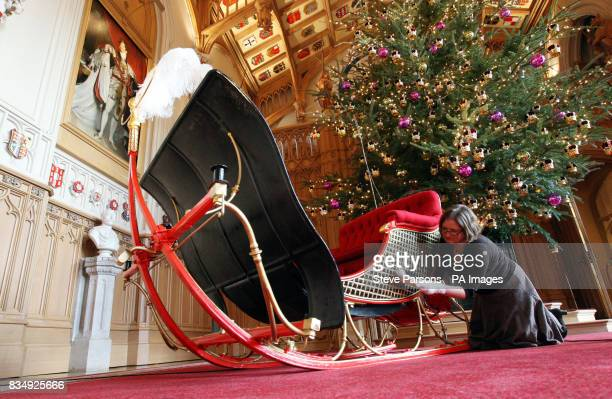 Curator at the Royal Collection Kathryn Jones carries out final checks on Queen Victoria's Sleigh which is to go on display for the first at Windsor...
