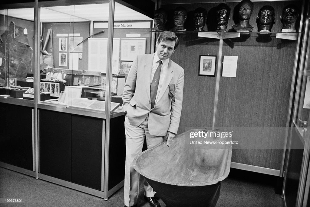 Curator Bill Waddell posed with various exhibits in the Black Museum or Crime Museum at New Scotland Yard headquarters of the Metropolitan Polce in...