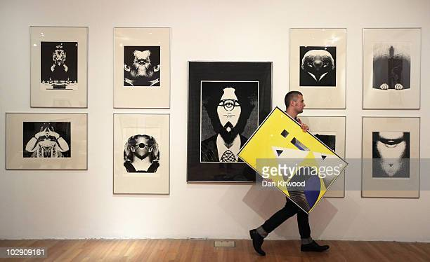Curator David Crowley puts the finishing touches to an exhibition by Polish artist and graphic designer Roman Cieslewicz at the Royal Academy of Arts...