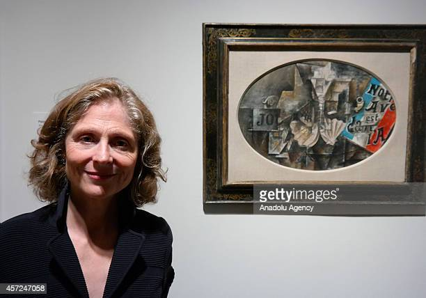 Curator Emily Braun art consultant to Leonard A Lauder poses with the art work 'The Scallop Shell ' by Pablo Picasso during the press preview for...
