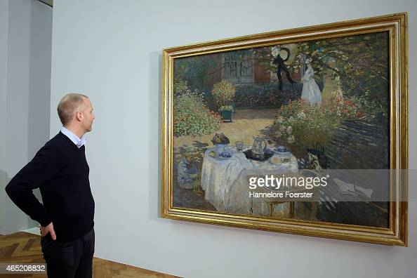 Curator Felix Kraemer view the painting 'Le Dejeuner' by artist Claude Monet during the preview of the Monet und die Geburt des Impressionismus...