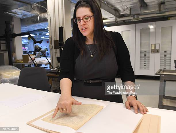 Curator Kyra Schuster goes over a manuscript of Primo Levi's famous holocaust memoir 'Survival in Auschwitz' which has just been donated to the US...