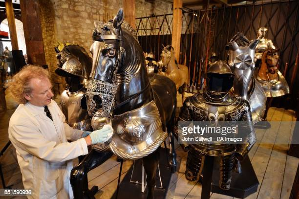 Curator of Armour Chris Smith cleans a 350 year old Armoured wooden Horse which will be part of the new Line of Kings Exhibition opening to the...