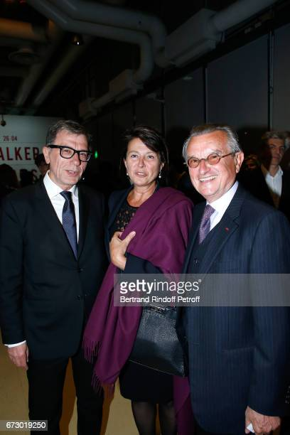 Curator of Centre Pompidou Serge Lasvignes GeorgesFrancois Hirsch and his wife pose in front the works of JeanPaul Goude during the 'Societe des Amis...