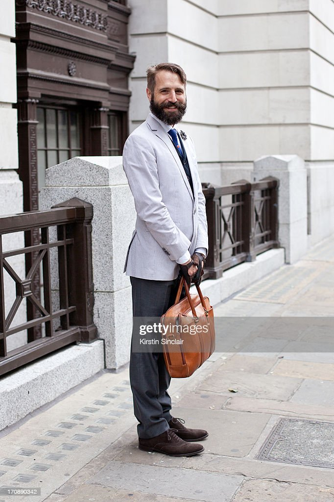 Curator of Fashion and Decorative Arts at the Museum of London Timothy Long wears Churches shoes, Italian Vintage gloves; Banana Republic trousers, jacket and shirt, Alexander McQueen waistcoat, and Lavenger bag on day 3 of London Collections: Men on June 18, 2013 in London, England.