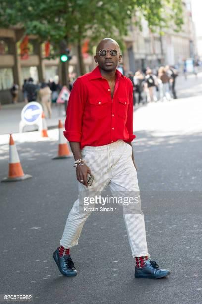 Curator of Sagaboi magazine Geoff Cooper wears a Woolrich shirt Skotch and Soda trousers Samsoe and Samsoe shoes Spektre sunglasses and Maxhosa socks...