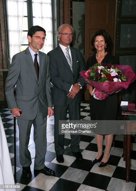 curator of the Chateau de Malmaison Amaury Lefebure King Carl Gustaf of Sweden and Queen Silvia of Sweden visit the Musee National Des Chateaux de...