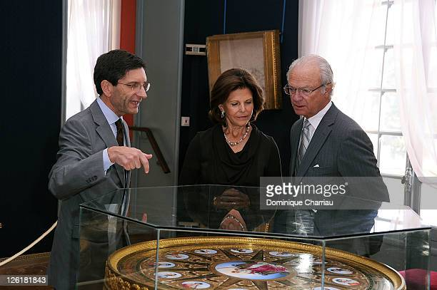 curator of the Chateau de Malmaison Amaury Lefebure Queen Silvia of Sweden and King Carl Gustaf of Sweden visit the Musee National Des Chateaux de...
