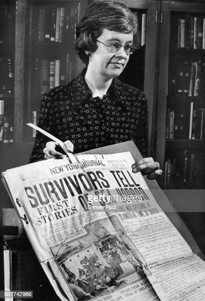 Curator of the documentary resources department of the Colorado State Museum holds newspaper clippings of the disaster of the Titanic in 1912 from...