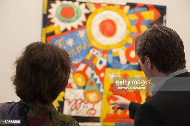 Curator of the exhibition Dieter Scholz talks to a visitor during the preview of the exhibition 'Marsden Hartley Die deutschen Bilder / The German...
