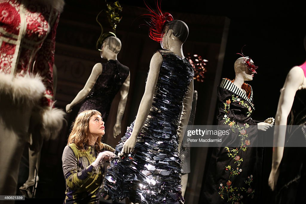 Curator Shonagh Marshall makes final touches to a Tearabul Songvich silver paillette A-Line dress at the Isabella Blow: Fashion Galore! exhibition at Somerset House on November 19, 2013 in London, England. Presented in partnership with the Isabella Blow Foundation and Central Saint Martins, the show features over 100 garments from designers such as Alexander McQueen and Philip Treacy. Selected from the personal collection of the late British patron of fashion and art, the exhibition runs from November 20, 2013 to March 2, 2014.