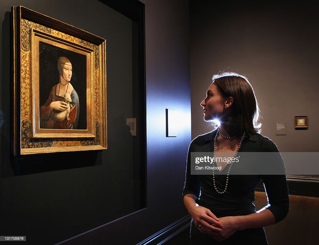 Curatorial assistant Francesca Sidhu, poses besides a painting by Leonardo da Vinci entitled 'Portrait of Cecilia Gallerani', (The Lady with an Ermine) which forms part of the Leonardo da Vinci: Painter at the Court of Milan exhibition at the National Gallery on November 07, 2011 in London, England. This exhibition brings together, for the first time, nine of da Vinci's fifteen surviving paintings. The global art world are hailing it as the greatest exhibition for over a century and the National Gallery has had to double their indemnity to a reported £3.3 billion in case of damage or theft. The exhibition runs from Wednesday November 9th until February 5th 2012 and is expected to draw record crowds.