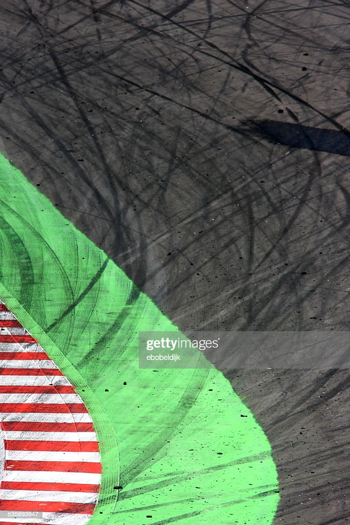 Curbstone with tyremarks on track : Stock Photo