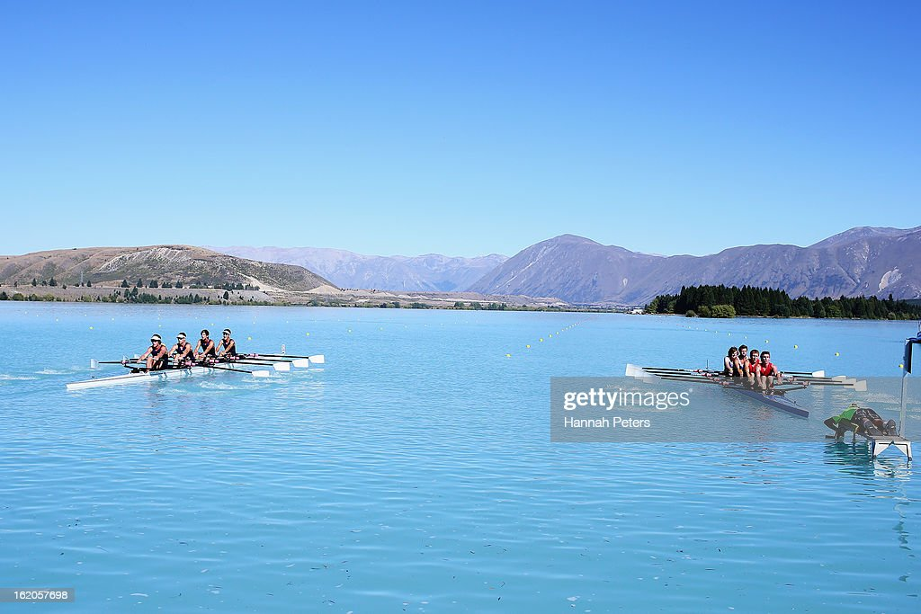 Cure Boating Club and Blenheim Rowing Club compete in the Men's Club 4X- heat during the New Zealand Rowing Championships at Lake Ruataniwha on February 19, 2013 in Twizel, New Zealand.