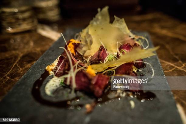 Cured beef loin sits over carupanera morcilla and celery ice cream in this appetizer dish prepared at Alto restaurant in the Chacao district of...